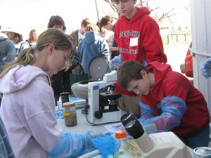 youth at microscopes